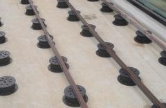 Podkladní hranoly na rektifikačních terčích Buzon